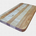 Square Cutting Board made out of mixed solid woods.